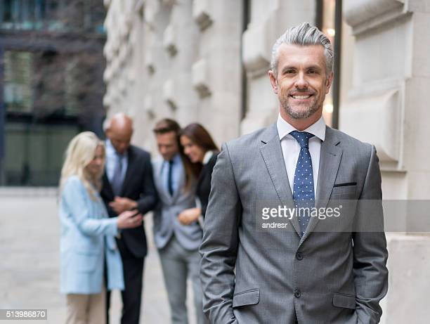 Successful business man leading a group