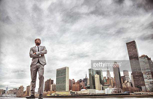 Successful business man looking away against the skyline
