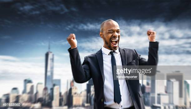 Successful business man smiling in new york city