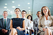Successful business men and women sitting in a conference room