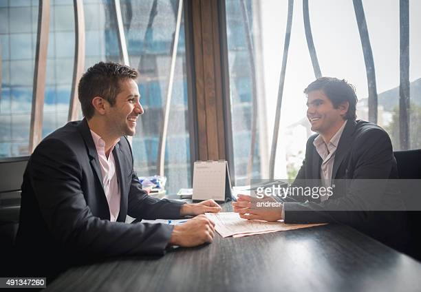 Successful business men in a meeting looking happy