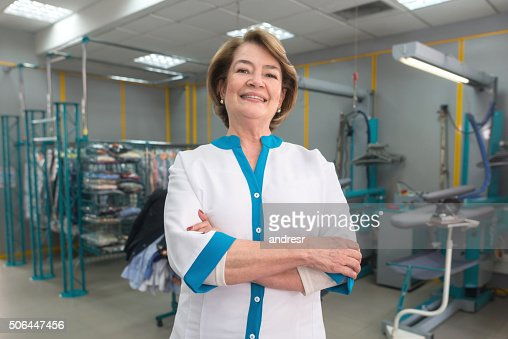 Woman Running A Laundry Service Shop Stock Photo | Getty Images