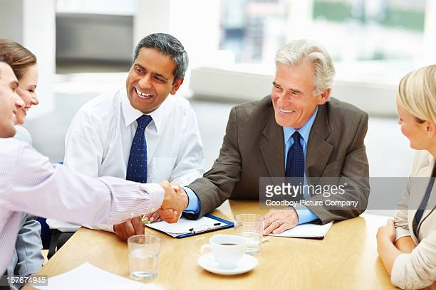 Successful business people shaking hands at conference room