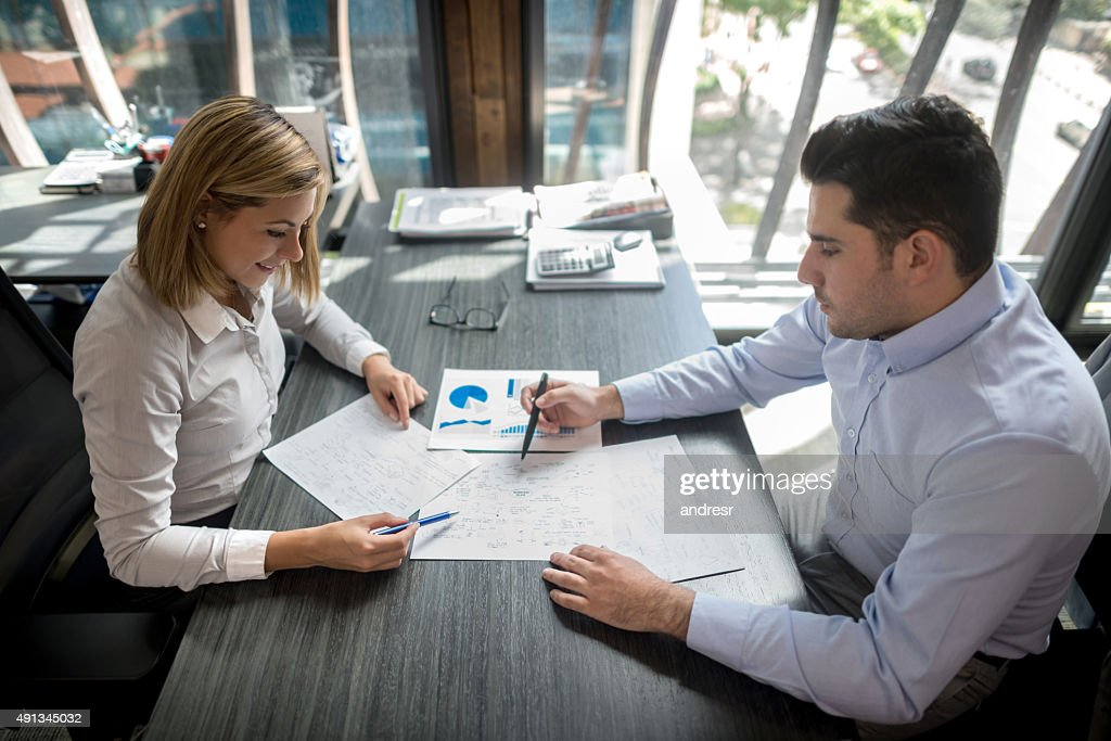 Successful business people working at the office : Stock Photo