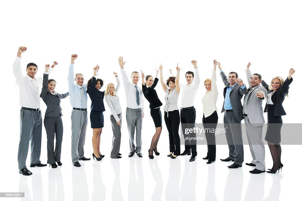 Successful business team with raised arms.