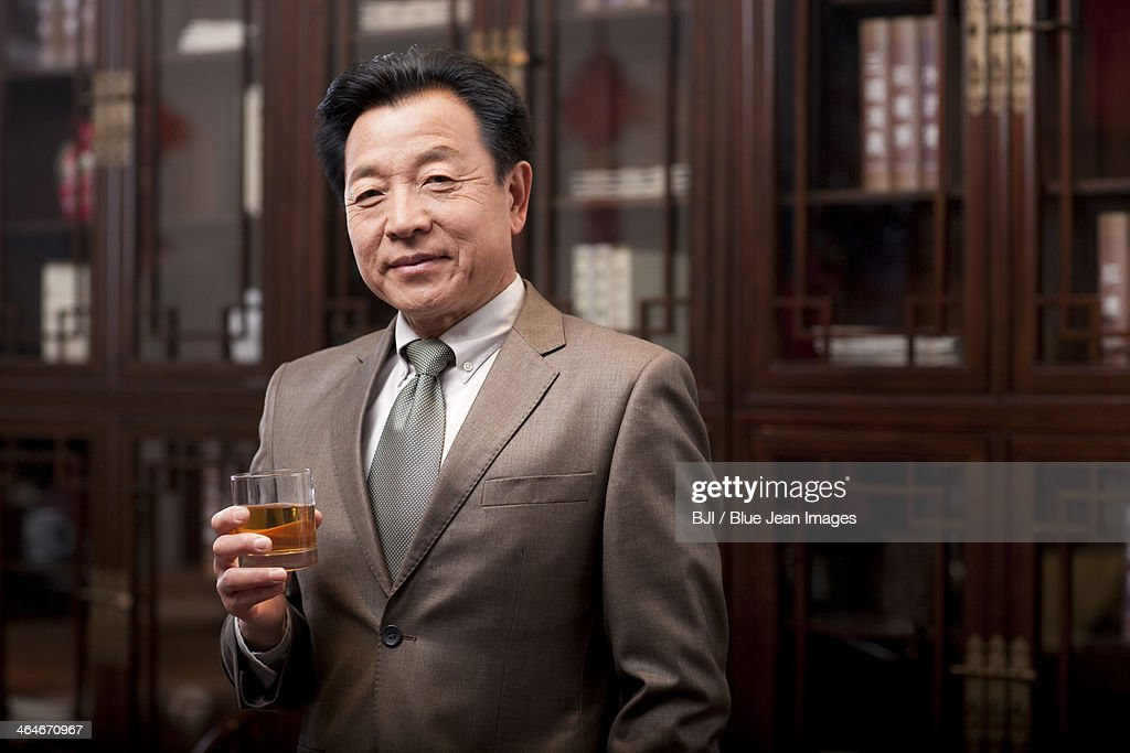 Successful businessman enjoying wine