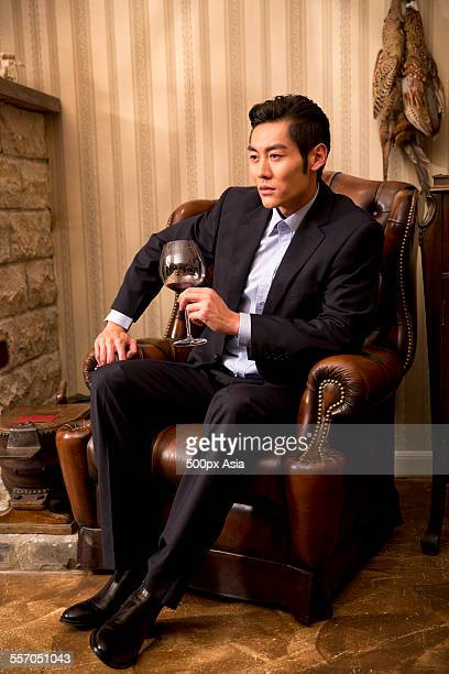 Successful Businessman Holding a Wineglass
