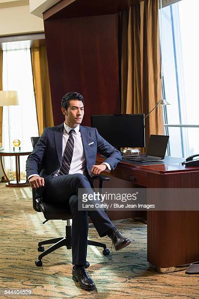 Successful businessman sitting in study