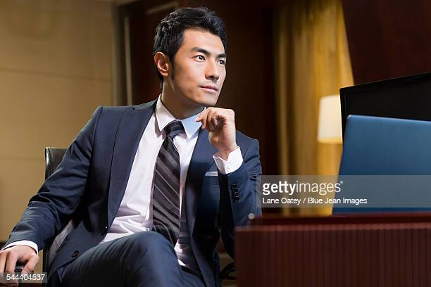 Successful businessman sitting in study