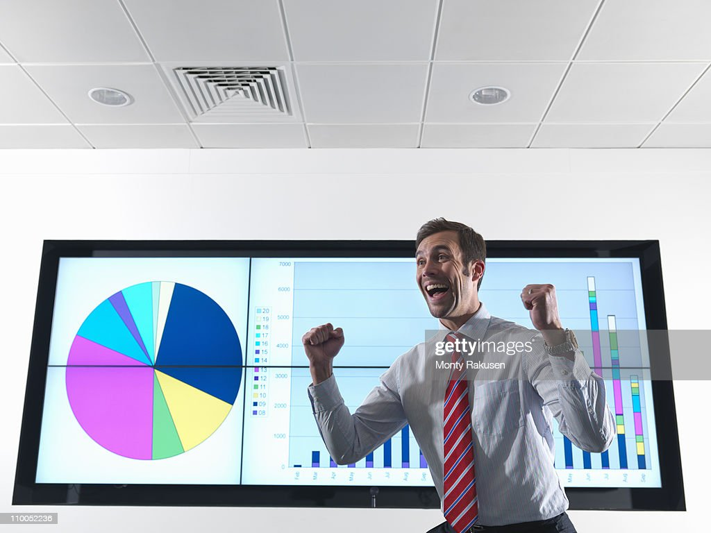 Successful businessman with graph : Stock Photo