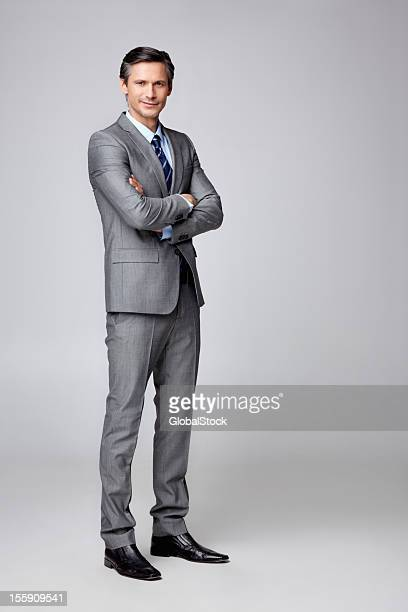 Successful businessman with hands folded - copyspace