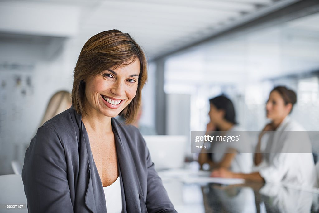 Successful businesswoman her team in background