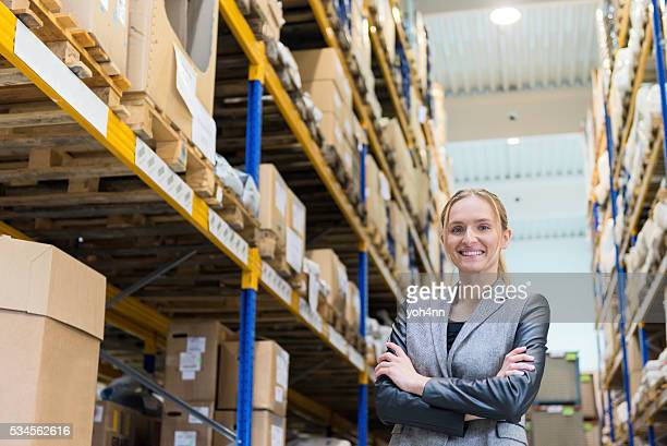 Successful female business person at warehouse