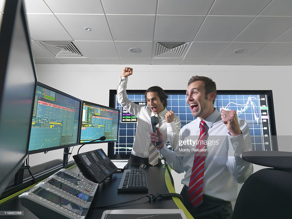 Successful financial trader and screens : Stock Photo
