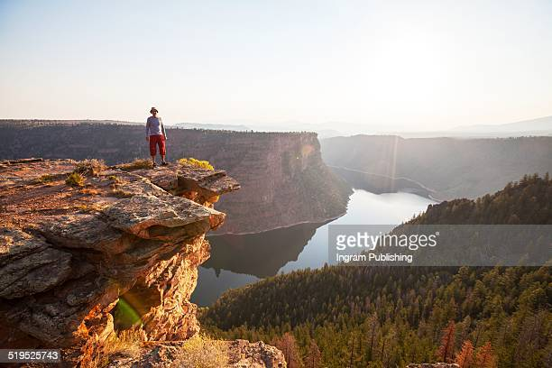 Successful man standing on cliff