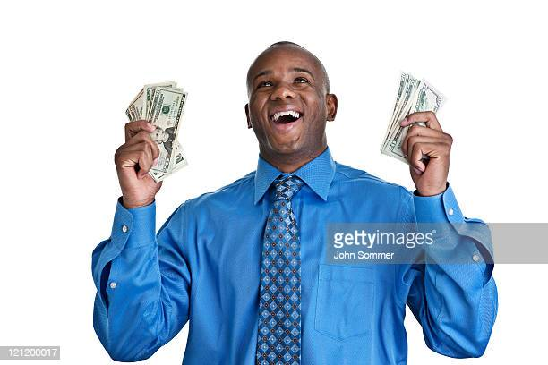 Successful man wearing a suit holding money