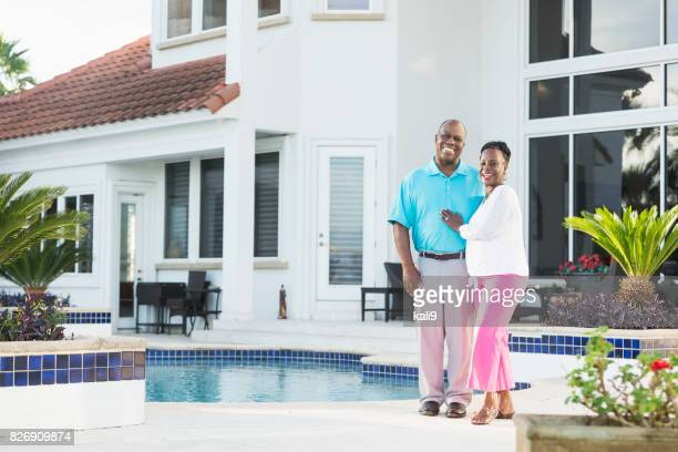 Successful senior African-American couple by pool