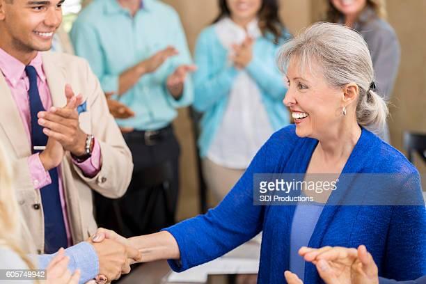 Successful senior businesswoman receives promotion