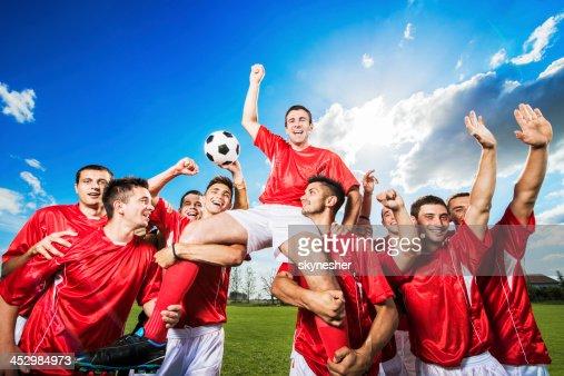 Successful soccer team against the sky.