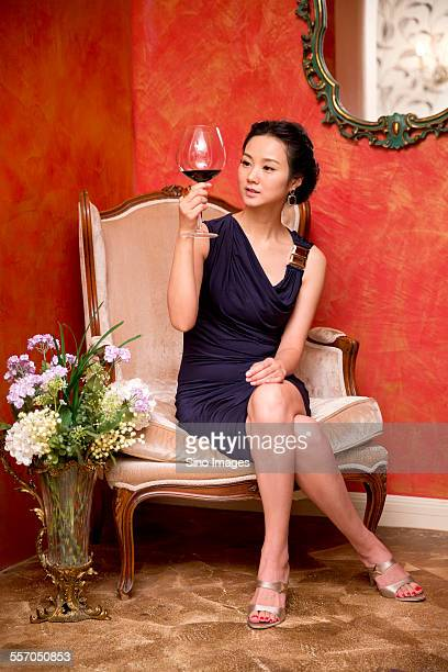 Successful Woman Drinking Red Wine on Sofa