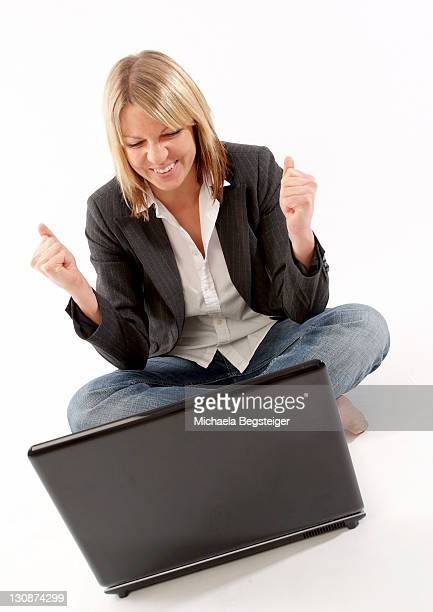 Successful woman using laptop
