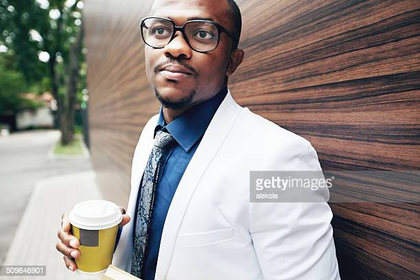 Successful young african man with coffee