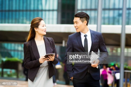Successful young Asian business people