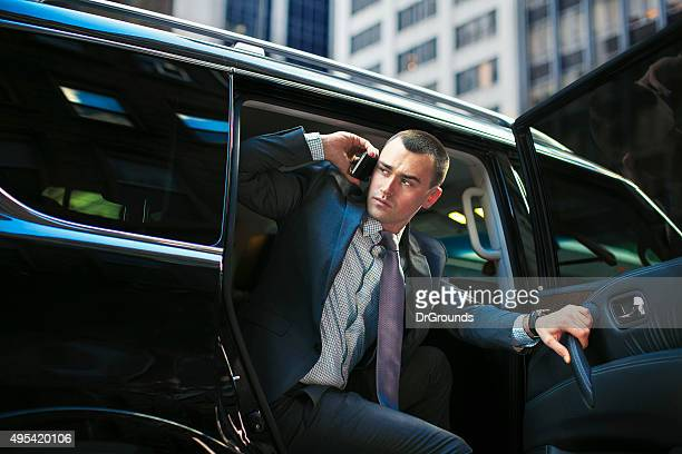 Successful young executive in luxury car