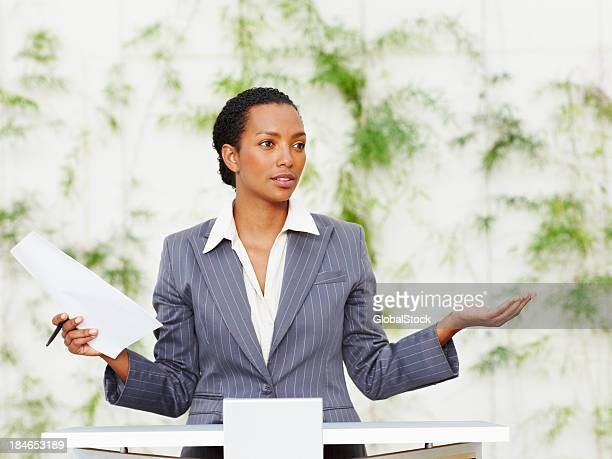 Successful young woman doing presentation with sketch