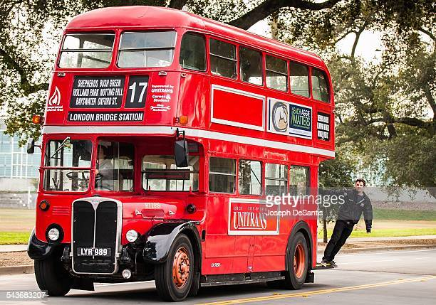 an oldfashion Londonborn doubledecker bus in a hightech small college town The old doubledecker busses with a student hanging on in Davis California...