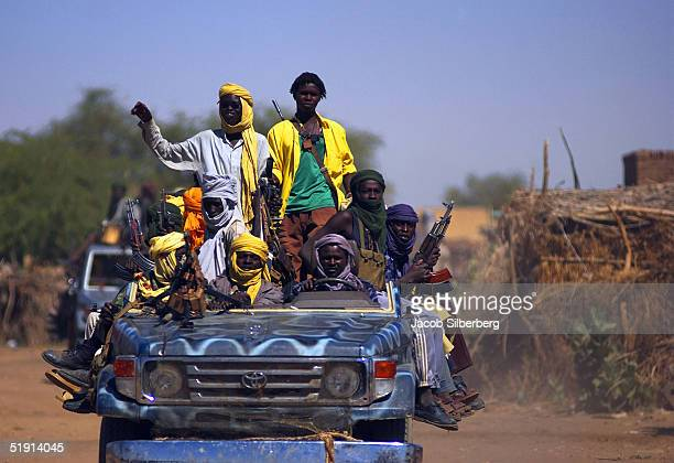 Sudan Liberation Army fighters ride in a truck December 1 2004 in Thabit North Darfur Sudan A recent upsurge in violence between SLA and Government...
