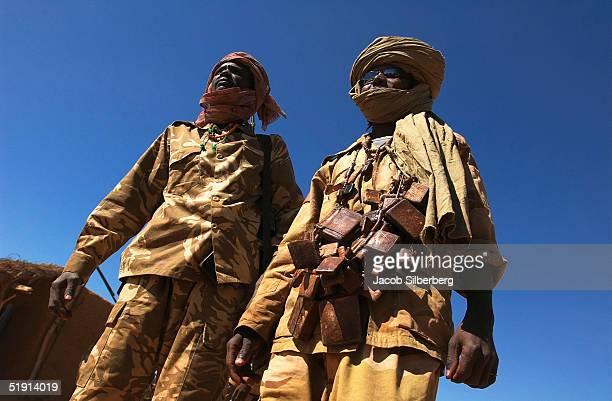 Sudan Liberation Army fighters wear charms containing lines from the Koran called hijabs December 1 2004 in Thabit North Darfur Sudan A recent...