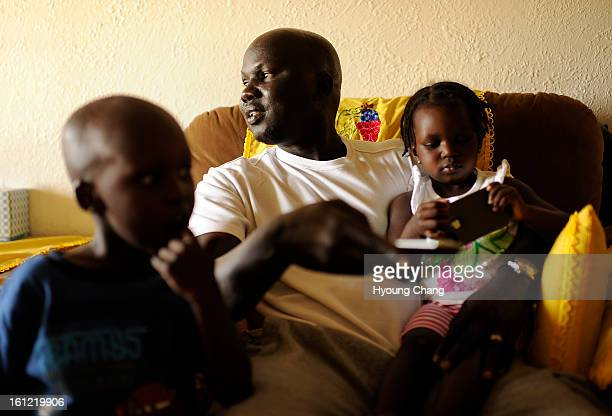 Sudan lost boy Gatbel Chamjock center spends time with his son Tethloach Gatbel age 3 and daughter Nyaken Gatbel age 1 at their house in Sterling...