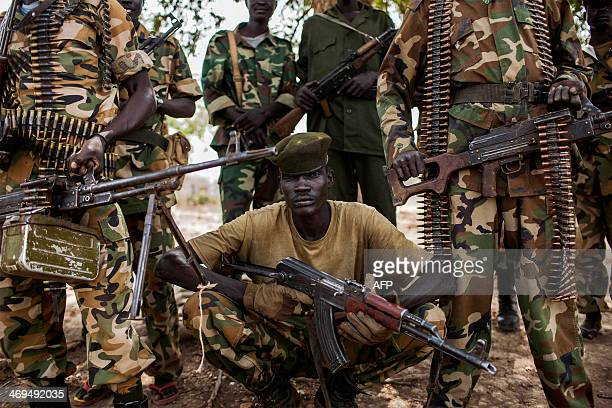 Sudan People's Liberation Army government soldiers from the 2nd Battalion pose at the SPLA headquarters in Nyang in the county of Yirol East South...