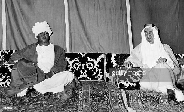 Sudan President Gaafar alNimeiry and Saudi Arabia King Faisal ibn Abd alAziz pose for the media in May 1972 in Jeddah at the beginning of Nimeiry...