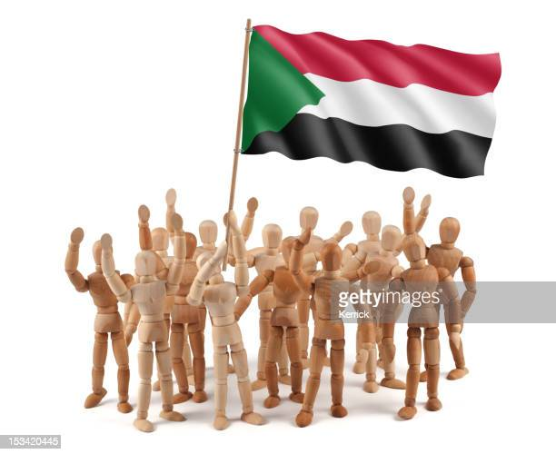Sudan - wooden mannequin group with flag