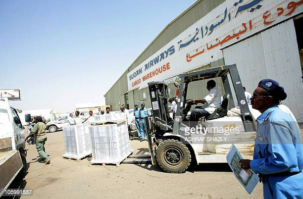 Sudanese airport employees receive shipments of voting kits to be used in the upcoming referendum on southern independence upon their arrival in...