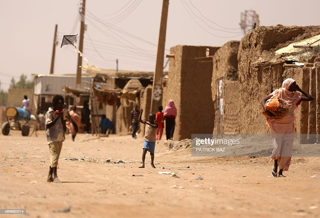 A Sudanese boy flies a kite in Khartoum's southern suburb of Mayo on April 14 2015 Mayo is mainly populated with displaced people from Darfur and...