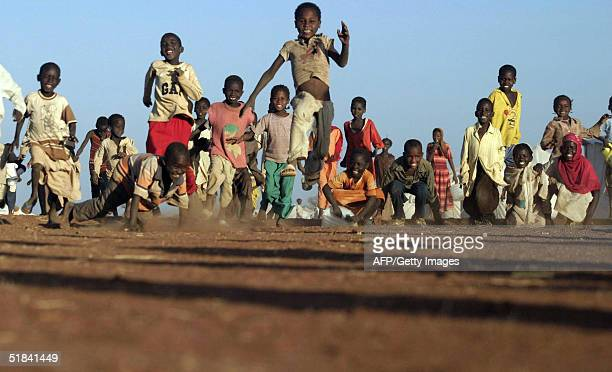 Sudanese children run together as they play at alSereif refugee camp on the outskirts of the southern Darfur town of Nyala 09 December 2004 The...