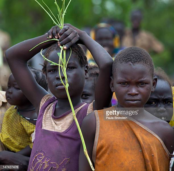 Sudanese children watch cargo unload at the airstrip at the Yida refugee camp along the border with North Sudan June 29 2012 in Yida South Sudan Yida...