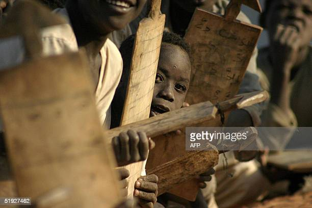 Sudanese displaced children attend a class at an outdoors makeshift school in Drage camp on the outskirts of the southern Darfur town of Nyala 08...
