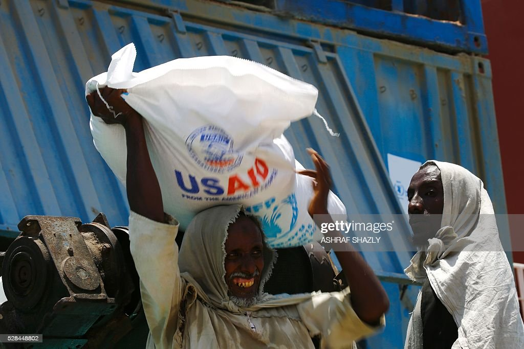 Sudanese dockers unload a US aid shipment organised by the US Agency for International Development and the World Food Programme at Port Sudan on the Red Sea coast, on May 5, 2016. Dockers began unloading tens of thousands of tonnes of food from a US aid ship destined for war-torn areas of Sudan, an AFP correspondent reported. The bulk carrier Liberty Grace docked in Port Sudan with a cargo of 47,500 tonnes of sorghum, a staple food in Sudan. SHAZLY