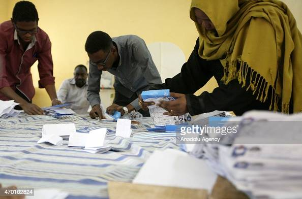 Sudanese election officials count ballots after the polls closed in the presidential and parliamentary elections in Khartoum Sudan on April 17 2015