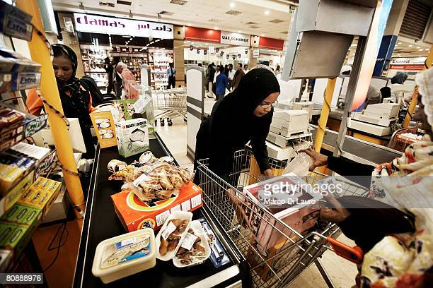 Sudanese family buy groceries at the hypermarket superstore at the Turkish/Sudanese owned Afra Shopping Mall on January 11 2007 in Khartoum Sudan...