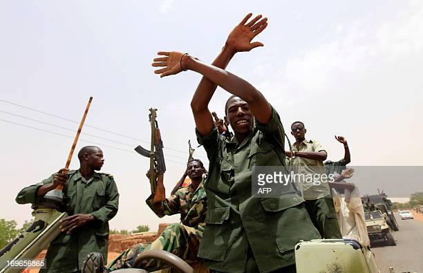 Sudanese forces celebrate after reportedly regaining control of the district of Abu Kershola a town which rebels of the Sudan Revolutionary Front...
