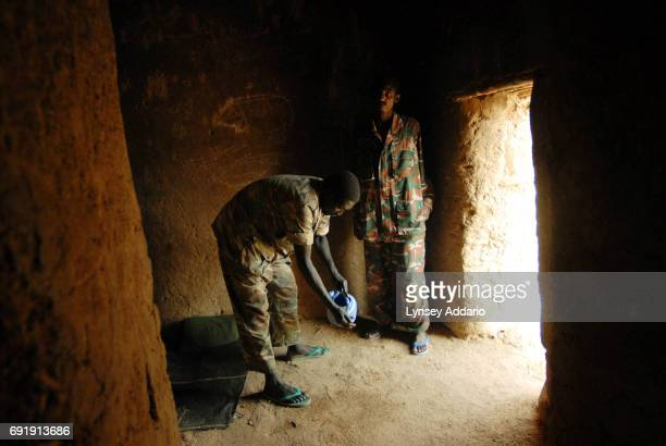 Sudanese government soldiers wash before prayer while being held in a prison in Iriba in northeastern Chad October 14 2006 Fierce fighting continues...