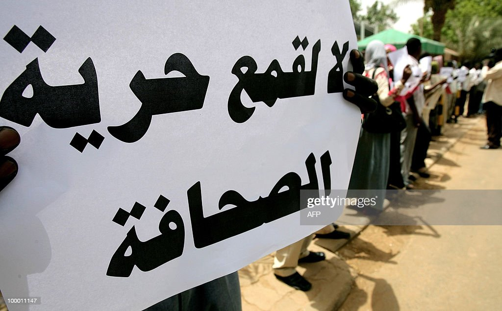 A Sudanese holds up a placard that reads 'No to the oppression of press freedom' during a protest against the storming by security forces of two newspaper offices in the capital Khartoum on May 20, 2010. Sudanese security officers stormed two newspapers yesterday tearing up articles ready for printing, employees said, despite a 2009 presidential decree promising to lift press censorship. Authorities went to the offices of the Ajras al-Hurriya, which is linked to the former southern rebel Sudan People's Liberation Movement and the independent daily Al-Sahafa, and confiscated articles. Sudan boasts around 30 titles in both English and Arabic published daily to represent all persuasions -- pro-government, Islamist or communist -- and showcase the country's multi-faceted political make-up.