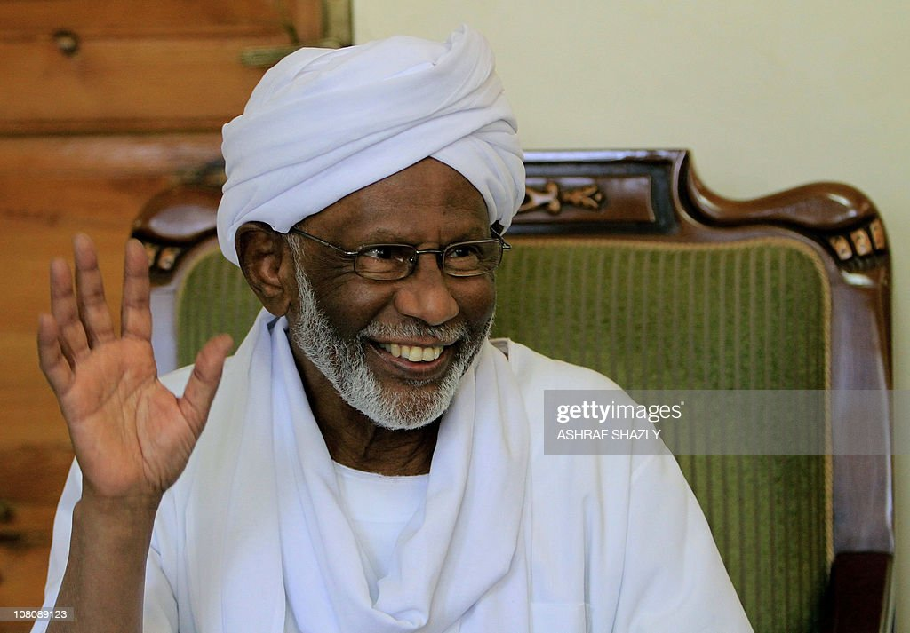 Sudanese Islamist opposition leader <a gi-track='captionPersonalityLinkClicked' href=/galleries/search?phrase=Hassan+al-Turabi&family=editorial&specificpeople=590997 ng-click='$event.stopPropagation()'>Hassan al-Turabi</a> smiles during an interview with AFP in Khartoum on January 17, 2011, during which he said that a Tunisia-style uprising is 'likely' in northern Sudan amid mounting economic woes and fears over the looming secession of the south.