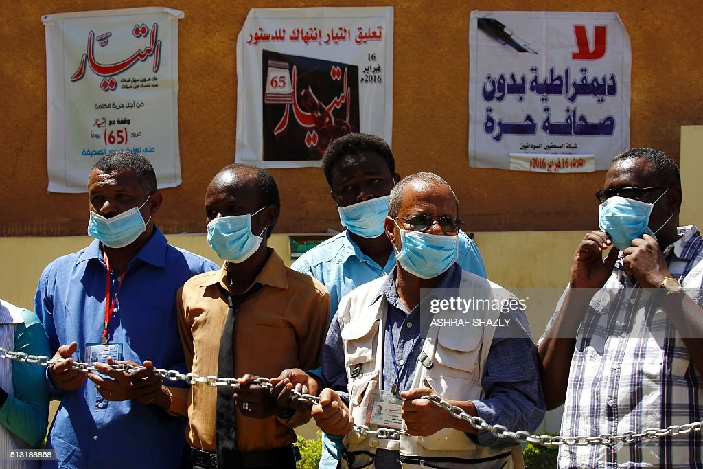Sudanese journalists pose with chains as they gather outside the Tayar newspaper to announce their intention to begin a hunger strike on March 1 in...