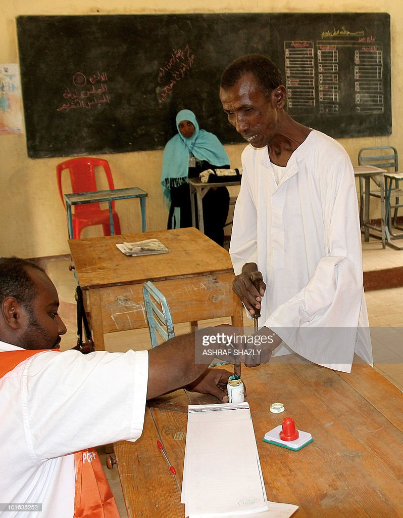 A Sudanese man dips his finger in ink as he arrives to cast his ballot at a voting station in Khartoum on June 5, 2010 during a re-election for the Sudanese parliament in some geographical constituencies .